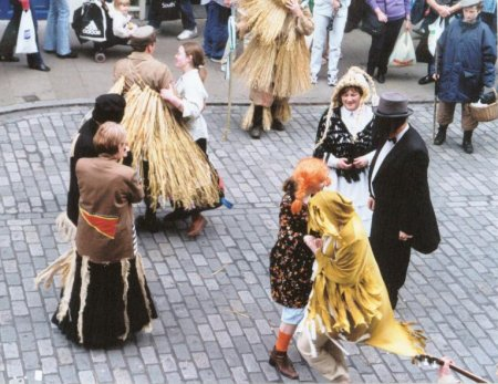 Aughakillymaude Community Mummers: Dancing, Big Head and Little Wit (without hat) with Beelzebub.